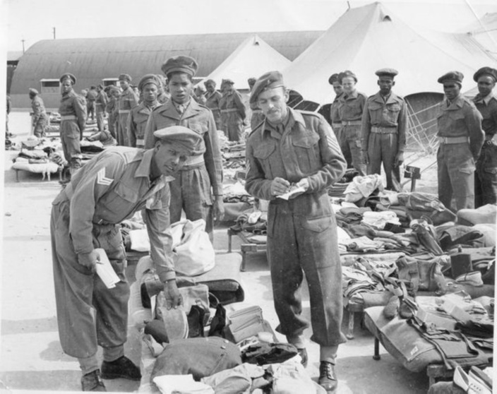 The photo shows Sgts Juggernauth and Donaldson on the foreground of 2 Trg Coy inspecting Mauritian soldiers' gear soon after they had landed in North Africa.